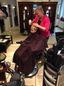H getting his hair cut with Lindy on a particularly rainy day.