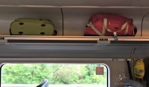 Above the seat train luggage storage